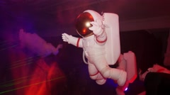 Figure of white astronaut suspend in air. Indoor. Doll. Spotlights, lasers Stock Footage