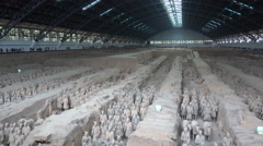Overview of statues of Terracotta Warriors, excavated in a pit near Xian China Stock Footage