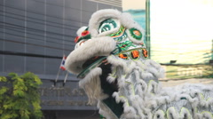Chinese lions performing in city Stock Footage