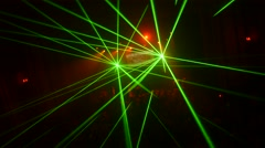 Green sparlking beams from laser show in crowded nightclub. Camera moves Stock Footage