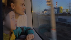 In Saint-Petersburg, Russia in train rides a young mother with a son and looking Stock Footage