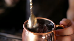 The bartender mixes a cocktail in a copper bowl Stock Footage