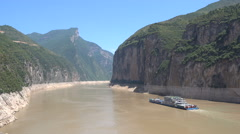 Commuting ferry boat sails through beautiful landscape, mountain cliffs China Stock Footage