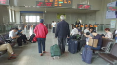 Walking towards the ticket gate at the Zhengzhou railway station in China Stock Footage