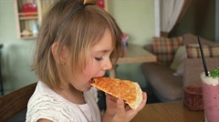 Little girl eat pizza with cheese in the cafe 4K Stock Footage