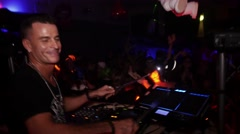Dj play at samplepad pro on stage of crowded nightclub. Lights Stock Footage
