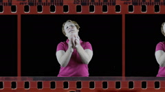Mature woman clapping in film strip Stock Footage