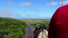 Horse and Carriage Ride Through Aran Islands in Ireland Blue Skies Stock Footage
