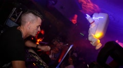Dj play at samplepad and mixing on stage of crowded nightclub at Halloween party Stock Footage
