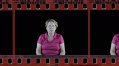 Mature woman showing angry emotion in film strip Stock Footage