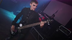 Rock guitarist with blood tears perform on stage Halloween party in nightclub Stock Footage