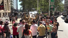 Tourists around the Charging Bull sculpture close to Wall Street, New York. Stock Footage