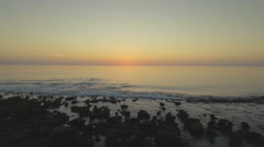 Beautiful Aerial Sunrise on the Ocean with Birds Stock Footage