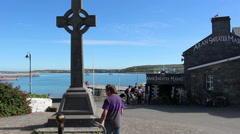 IRELAND AUGUST 2016 Celtic Cross on the Aran Islands People Walking Stock Footage