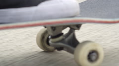 SLOW MOTION CLOSE UP: Skateboarder skating, pushing skate deck, wheels spinning Stock Footage