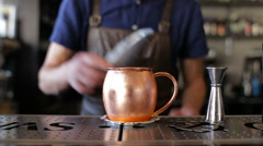 Barman is decorated with a cocktail in a copper bowl Stock Footage