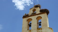 Old church bell tower with moving clouds time lapse and blue sky background Stock Footage