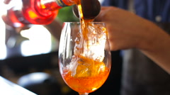 The bartender adds liquor in a cocktail Stock Footage