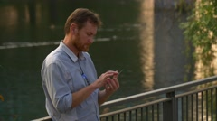 The Man Searches For Mobile Number of His Friend in a Telephone Directory Stock Footage