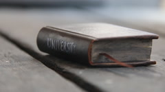 University - text on the book Stock Footage