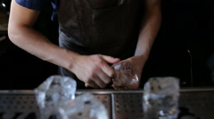 Bartender mannually crushed ice with wooden metal knife Stock Footage