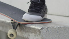 SLOW MOTION EXTREME CLOSE UP DOF: Skater sliding with skate on concrete bench Stock Footage