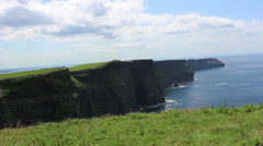 Cliffs of Moher in Ireland Cliffs into Ocean Water Blue Skies Stock Footage