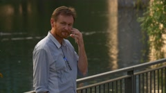 Man Talking on Cell Phone With Business Partner Stock Footage
