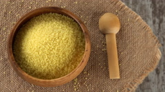 Raw couscous on burlap rotating. Seamless loopable. 4K Stock Footage