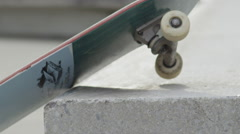 SLOW MOTION EXTREME CLOSE UP DOF: Skater sliding with skate on bench and falling Stock Footage