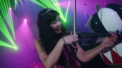 Violinist with crown perform on stage at Halloween party in club. Slow motion Stock Footage