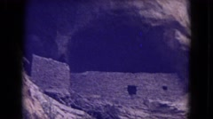 1973: cliff face with walls and window NEW MEXICO Stock Footage