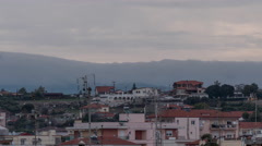 Timelapse in Nea Kallikratia, Greece at sunset seen roofs of houses with Stock Footage