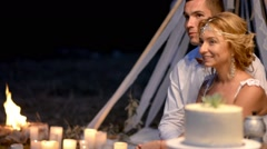 A romantic night at the nature with candles and fire Stock Footage
