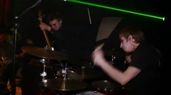 Drummer at stage on Halloween party. Guitarist with blood tears. Slow motion Stock Footage