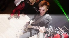 Guitarist with blood tears stage on Halloween party. Slow motion. Go go dancers Stock Footage