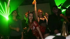 Go go dancers on stage of Halloween party. Rock band performance. Slow motion Stock Footage