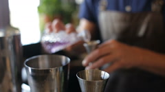 The bartender added ingredients in a metal cup Stock Footage