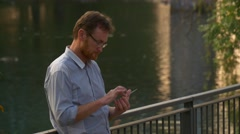 Man Reads an Electronic Book on the Mobile Phone Stock Footage