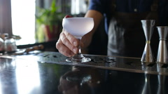 The bartender serves a cocktail client Stock Footage