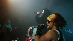 Two rap artists perform on stage at Halloween party in club. Slow motion Stock Footage