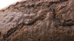 Crackled browny type shiny cake surface close-up panning 4K 3840X2160 UltraHD Stock Footage