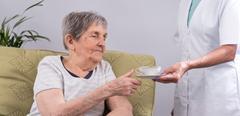 Nurse taking care of an elderly person Stock Photos
