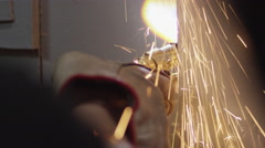 Welding sparks falling out while a worker welding the metal door Stock Footage