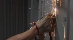 Worker welding a metal door Stock Footage