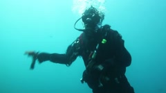 Diver firing with a flare gun under the sea Stock Footage