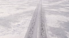 Aerial of snow covered road on frozen landscape Stock Footage