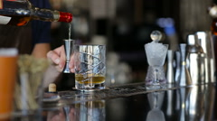 Adding alcohol in short cocktail Stock Footage