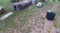 Aerial Fly-Over Of Abandoned Survivalist Bunker And Vehicles- Low Stock Footage