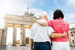 Rear View Of Senior Couple Standing In Front Of Brandenburg Gate Stock Photos